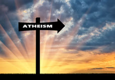 Road sign of atheism at sunset Stock Photos