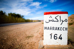 Road sign in the atlas mountains,morocco. Road sign for marrakesch in the atlas mountains,morocco royalty free stock image