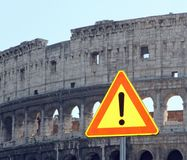 Road sign of attention for the rockfall from the Colosseum. Road sign with an exclamation point of attention for the rockfall from the Colosseum stock image
