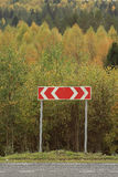 Road sign among autumn forest Stock Image