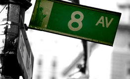 Road sign 8 avenue on the traffic light pole in New York City Royalty Free Stock Photography