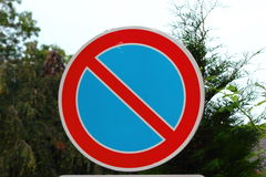 Road sign. On the background of trees road sign, which indicates no parking Stock Images