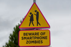 Road sign - beware of smartphone zombies. Finland royalty free stock photo