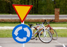 A road sign with bicycles. In the background Stock Images