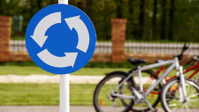 A road sign with bicycles 2. A road sign with bicycles in the background Stock Images