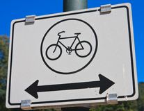 Road sign. Bike with arrows Stock Photos