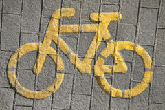 Road sign for bikes and cyclists outdoors. Bicycle way symbol on city street as a background stock images