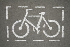 Road sign for bikes and cyclists outdoors. Bicycle Way Symbol On City Street As A Background royalty free stock image