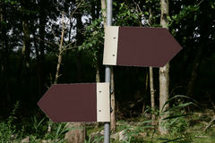 Road Sign. A blank roadsign pointing in two directions. With space for own text royalty free stock image