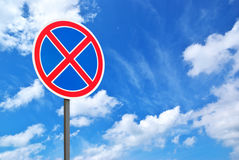 Road sign and blue sky Royalty Free Stock Photo