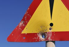 Road sign with bullet holes Royalty Free Stock Photo
