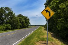 Road sign with bullet holes in a country road in the State of Mississippi. USA stock photos