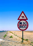 Road sign with camel. In the middle of the desert Stock Photo
