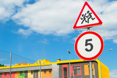 Road sign caution children, 5 km speed limit sign Royalty Free Stock Photography
