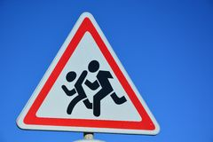 Road sign CHILDREN AT PLAY. Against the background of the blue sky Royalty Free Stock Photo