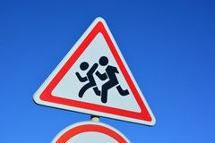 Road sign CHILDREN AT PLAY. Against the background of the blue sky Stock Photography