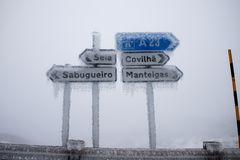 Road sign city with ice. Road sign city Seia Covilha Sabugueiro Manteigas with ice Stock Photography