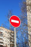 Road Sign Closeup. Ban road sign in city against blue sky background stock image