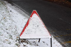 Road sign covered in snow Stock Photography