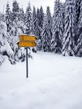 Road sign covered with snow Royalty Free Stock Photography