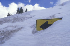 A road sign covered by snow Stock Photos