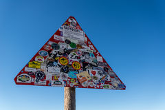Road sign covered with stickers stock images