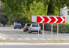 Road sign curve chevrons on a city street Stock Photos