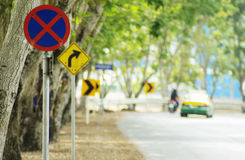Road sign. Curve road sign on down hill. A diverse background Royalty Free Stock Photo