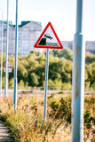 Road sign of danger falling into the water Royalty Free Stock Photo