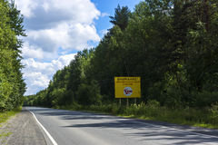 Road with sign of dangerous area Stock Photography