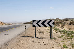 Dangerous curve. Road sign about dangerous curve on a way through the Negev desert,Israel stock images