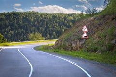 Road sign dangerous turn royalty free stock image