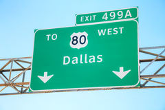 Road sign with the direction to Dallas Royalty Free Stock Image