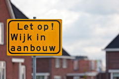 Road sign with Dutch text houses under construction Royalty Free Stock Image