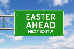 Road sign with Easter Ahead text Royalty Free Stock Photography