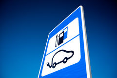 Road sign of electric car battery recharge station stock photography