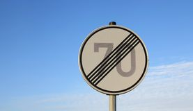 Road sign - the end of the permissible speed seventy Royalty Free Stock Photography