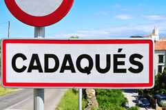 Road sign at the entrance of Cadaques, in Spain Royalty Free Stock Images