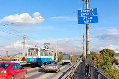 Road sign about Europe and Asia border. MAGNITOGORSK, RUSSIA – SEPTEMBER 27: Plate with the inscription of the border between Europe and Asia on September stock image