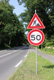 Road sign fifty stock image