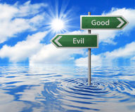 Road Sign in Flooded Area. Good & Evil Road Sign in Flooded Area Royalty Free Stock Photo