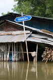 Road sign in flooded village in Thailand Royalty Free Stock Photos