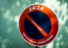 A road sign forbidding deliveries on Sundays and public holidays. A French road sign forbidding deliveries on Sundays and public holidays royalty free stock image