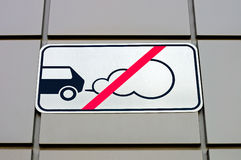 Road sign forbidding parking of cars with the working engine Royalty Free Stock Photos