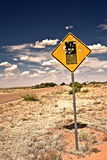 Road sign full of shotgun holes Royalty Free Stock Photo