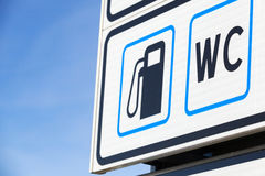 Road sign with gas station and WC icons Royalty Free Stock Image