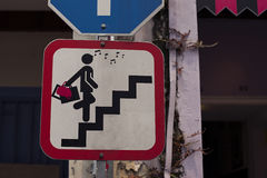 Road sign with glamor woman. On stair Royalty Free Stock Images