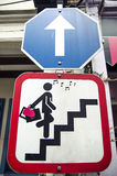 Road sign with glamor woman stair. In Singapore Stock Photo