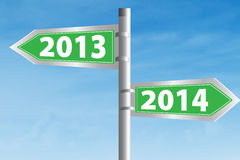 2013 and 2014 Road Sign. Going ahead to year 2014 and leaving the year 2013 behind royalty free stock photo