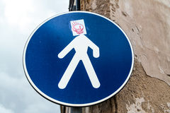 Road sign with graffiti Royalty Free Stock Photos